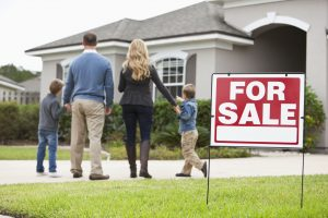 This happy family looking at a new home for sale can be your family, and our long distance movers Twin Cities can get you there.
