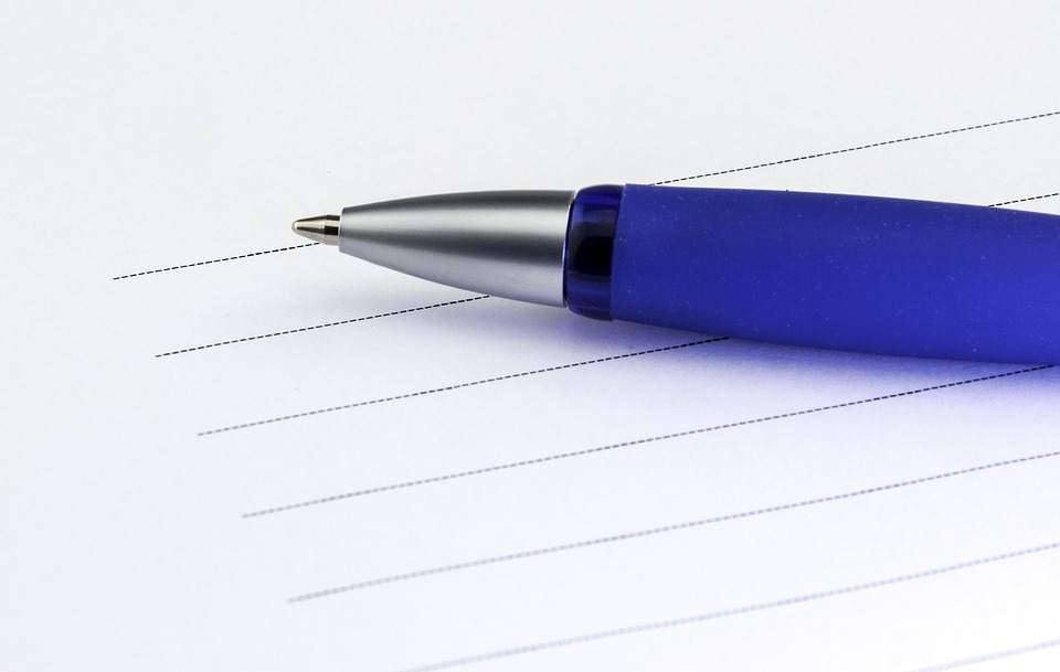 A pen and paper for your list of movers Eagan services.