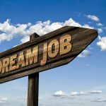 a sign saying dream job pointing to the right