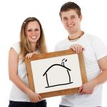 Couple holding a pictured house