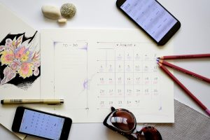 planner, pen, sunglasses, android on the table