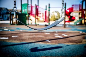 image of a playground swing