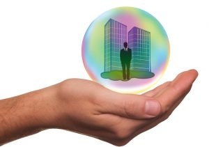 A man in a bubble in the palm of a hand
