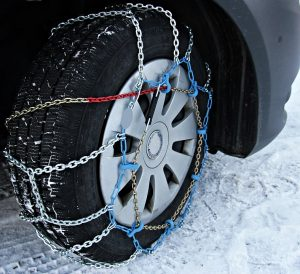Chains on winter tires used to get out of snow is one of the downsides of driving a truck in winter