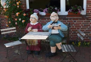 figurines of a senior couple