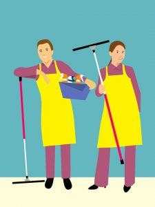 Cartoon cleaning couple cleaning storage unit as one of the traits of good storage facilities