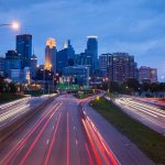 Highway and buildings at night is one of the best ways for young people to spend time in Minneapolis.