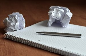 A paper and pen you use to make a plan before you let your kids help with the move