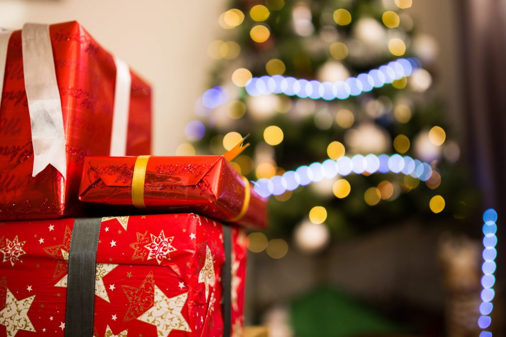 Make your kids happy by placing wrapped up Christmas gifts under the tree!