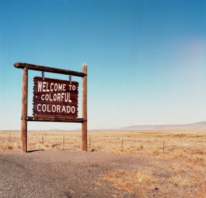 Welcome sign when moving from Minnesota to Colorado