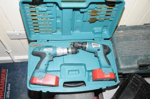 Packing power tools in a factory box