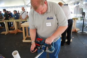 A man testing a power drill