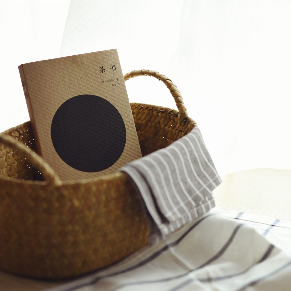 Alternative in-house packing materials. A basket with book and towel inside.